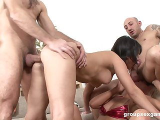 Bitches are being hard fucked in a unrestrained foursome