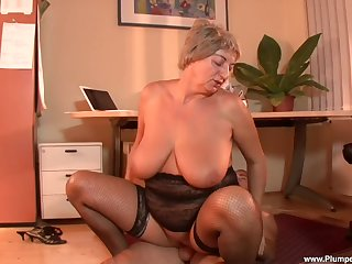 Censorious old slattern Eva F. puts on stockings to seduce a younger guy