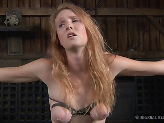 Redhead chick Ashley Lane tied regarding and poked with sex toys